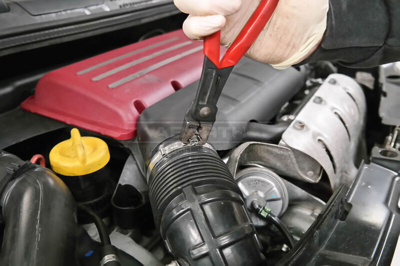 <p>Unclip the air intake flexi pipe FROM the air filter box and the strap around the intake pipe TO the air box.